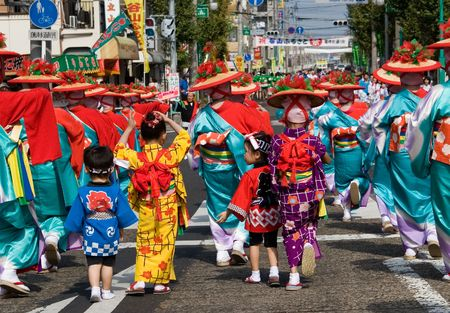 Kagoshima City, Japan, October 22, 2006. Young children in kimono dance with an adult group during the Taniyama Furusato Matsuri dance festival Editorial