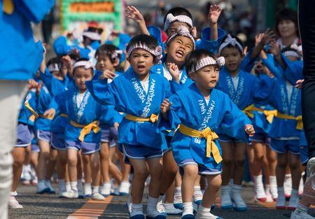KAGOSHIMA CITY, JAPAN - OCTOBER 22: Young Japanese children dance in a parade  during the Taniyama Furusato Matsuri dance festival October 22, 2006 in Kagoshima City, Japan .