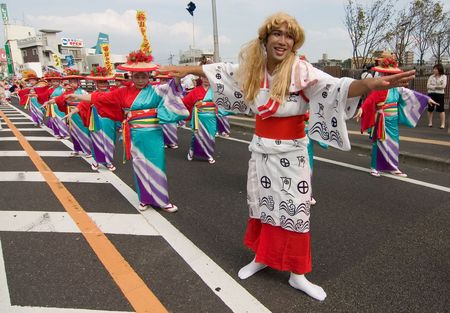 Kagoshima City, Japan, October 22, 2006. A man dressed as a woman in kimono dances with a group of women during the Taniyam Furusata Matsuri. Editorial