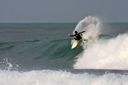 Surfer kickback on a wave.