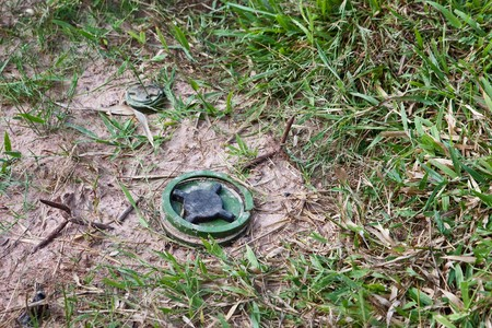 landmine and spikes in a Cambodian field