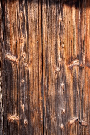 Background of Aged and textured wood siding on an old Japanese house.