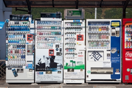 outside machines: KAGOSHIMA CITY, JAPAN - APRIL 20: Vending machines lined up outside selling cigarettes, beer, alcohol, and other drinks. Kagoshima City, Japan, April 20, 2011.  Editorial