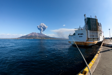 KAGOSHIMA CITY, JAPAN - FEBRUARY 15: Mt Sakurajima erupting with a ship in foreground. The volcano erupted over 800 times in 2010, Kagoshima City, Japan, February 15, 2011.