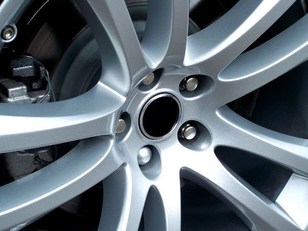 A close up photo of a sports car alloy wheel. Perfect for sports concept designs.