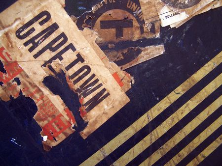 One of a series of images of abstract, rough and textured photographs of a vintage 1920s travel case.