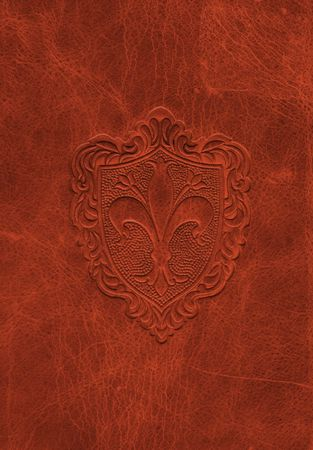Vintage leather texture with the fleur-de-lis symbol also known as the symbol of France, Quebec, Switzerland, Florence and New Orleans.