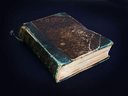 Vintage Broken Book against a black background photo