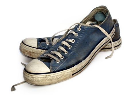 Old used and worn out sneakers or trainers Stock Photo