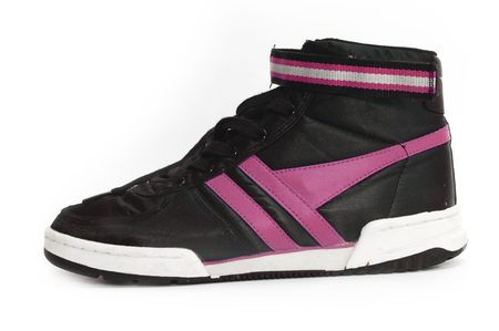 Old pair of cool old retro style sneakers or trainers photo