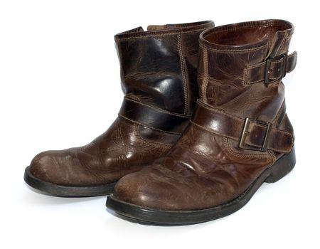 zapatos de seguridad: Un par de viejos piel marr�n desgastado botas de trabajo  Foto de archivo