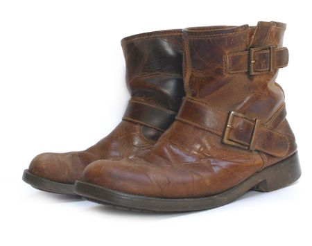 and worn out: A pair of old brown leather worn out work boots