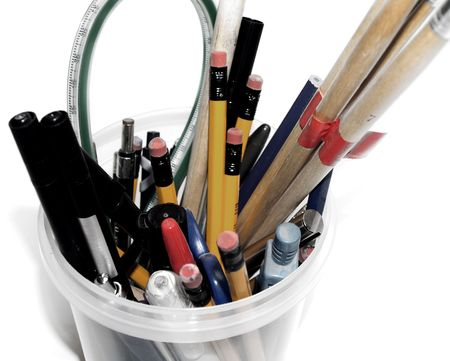 Back to school concept of pens and pencils in a pot photo