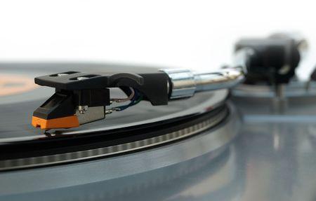 bpm: Vinyl record player stylus close up detail image