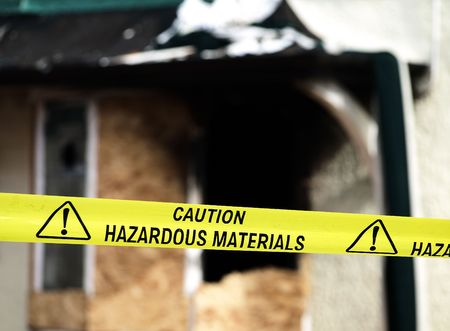 police tape: Caution Hazardous Materials Yellow Police Tape Stock Photo