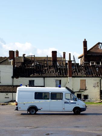Crime Scene Fire Damaged House with police van outside Stock Photo - 2926604