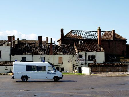 Crime Scene Fire Damaged House with police van outside Stock Photo - 2926625