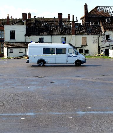 Crime Scene Fire Damaged House with police van outside photo