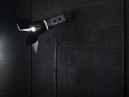Photography studio light against a black brick wall background Stock Photo - 2973079