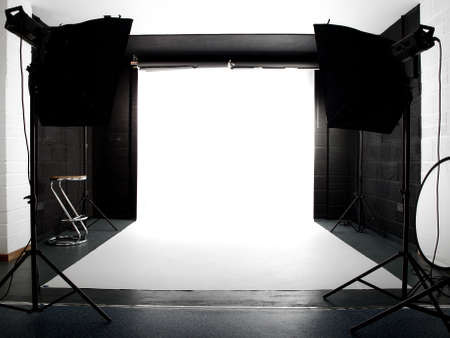 Empty studio with lights and white background