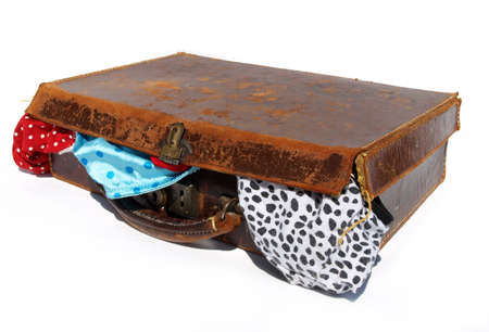 rushed: Battered old brown leather suitcase with underwear coming out the sides