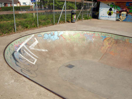Empty skate or bmx park with graffiti on the walls