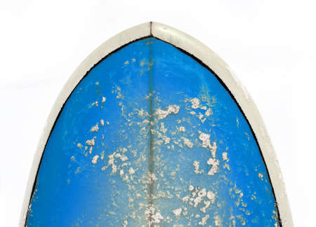 Nose of a bright blue surfboard against a white background photo