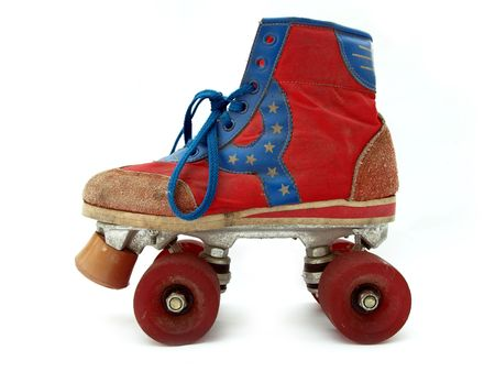 Vintage style old roller skate isolated against white background