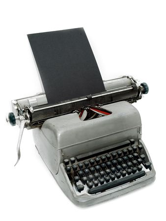 Vintage old type writer against a white background photo