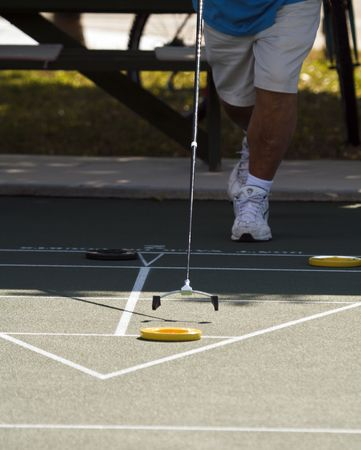 Shuffleboarder goes for the block at a senior citizens park in Florida Stok Fotoğraf