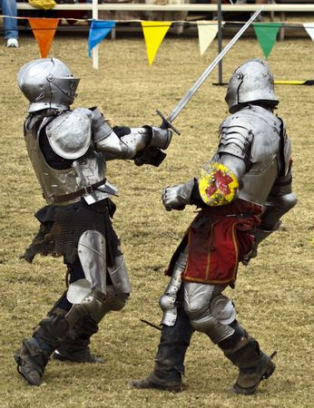 chain armour: Knights battle in hand to hand combat Stock Photo