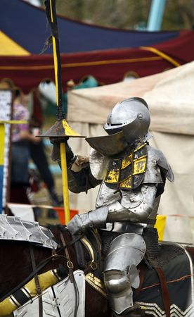 Knight in armor prepares for the joust Stok Fotoğraf