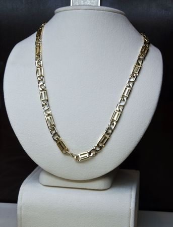 Diamond necklace on display for customers to peruse photo