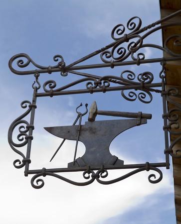 blacksmith shop: Sign indicating the location of the blacksmith shop