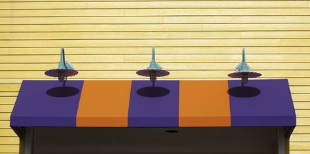 coloful: Lights show their shadows on the coloful business awning