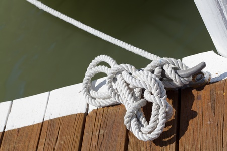 docking: Rope on a post where the ship is tied up at the pier