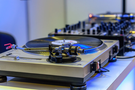 scratcher: Professional  DJ console with knobs and a disc scratcher. Stock Photo