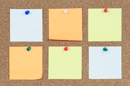 Six Various And Blank Sticky Notes On An Office Cork Bulletin Board. Stock  Photo