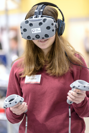 htc: Krakow, Poland - February 23, 2017: Presentation of HTC VIVE - Virtual Reality System by 1000realities Company during Mobile-IT Exhibition. Editorial