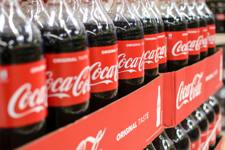 plastico pet: Nowy Sacz, Poland - March 29, 2017:  Bottles of Coca-Cola drink from the Coca-Cola Company in a Tesco Hypermarket.