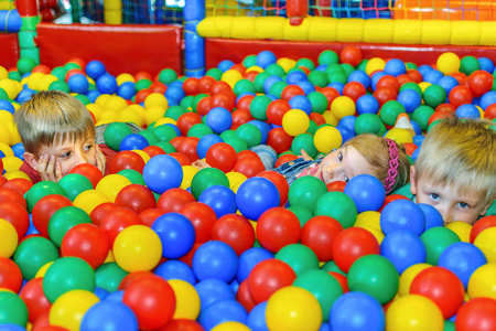 playcentre: Children playing in a ball pool at the party.