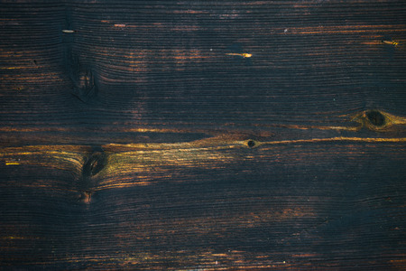 painted wood: Old and archival dark brown wooden plank as a vintage background.
