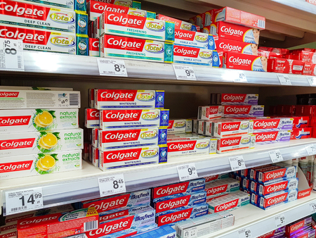 Nowy Sacz, Poland - July 06, 2017: Various Colgate toothpaste products for sale in the Carrefour Hypermarket. Colgate is a brand of toothpaste produced by Colgate-Palmolive Company.
