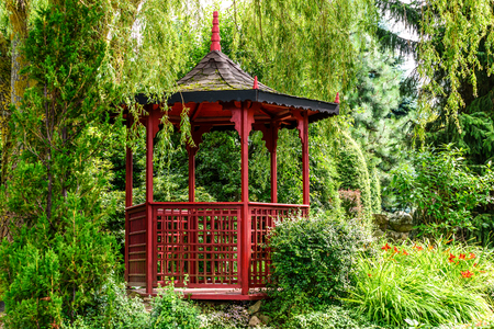 Charmant Stock Photo   Stylish Red Pagoda In A Japanese Garden Among Trees And Green  Plants In Sunny Day.