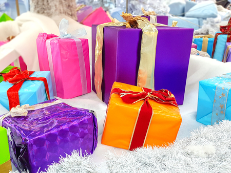 Concept image of various multicolored Christmas gifts under a Christmas tree