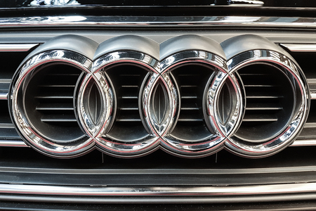 Lubin, Poland - November 17, 2017: Audi emblem on a car grill. Audi is a German automobile manufacturer that designs,  produces and distributes luxury automobiles.