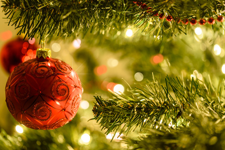 beautiful christmas background red baubles on a background of blurred lights on a christmas tree - Beautiful Christmas Photos