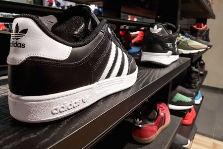 Lubin, Poland - November 17, 2017: Collection of trendy Adidas sports shoes offered for sale in the Adidas Shop. Adidas AG is a German multinaitional corporation that designs an manufactures sportswea