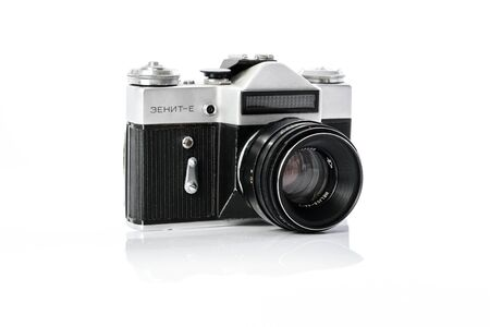 Krynica, Poland - December 29, 2017: Legendary Soviet 35 mm SLR camera Zenit-E with Helios 44mm lens isolated on white background in close-up. 에디토리얼