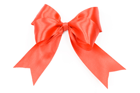 Shiny red satin bow on a white background in close-up ( high details) Stock Photo
